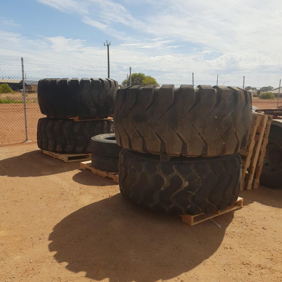 a stack of four R25 Earth Moving Tyres